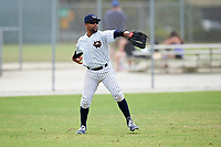 Western Connecticut Colonials left fielder Tre' Gause (25) throws the ball in during the first game of a doubleheader against the Edgewood College Eagles on March 13, 2017 at the Lee County Player Development Complex in Fort Myers, Florida.  Edgewood defeated Western Connecticut 3-0.  (Mike Janes/Four Seam Images)