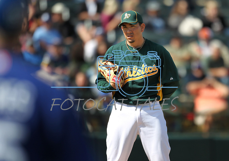 Oakland A's pitcher Brian Fuentes checks a runner in a Cactus League preseason game between the Dodgers and the A's in Scottsdale, Ariz., on Wednesday, March 7, 2012. The game ended 3-3..Photo by Cathleen Allison