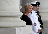 GETTY POOLWASHINGTON, DC - AUGUST 31:  (L-R) Cindy McCain, Jack McCain, and James McCain watch as a military honor guard team carries the casket of the late-Sen. John McCain (R-AZ), into the U.S. Capitol, August 31, 2018 in Washington, DC. The late senator died August 25 at the age of 81 after a long battle with brain cancer. He will lie in state at the U.S. Capitol today, a rare honor bestowed on only 31 people in the past 166 years. Sen. McCain will be buried at his final resting place at the U.S. Naval Academy on Sunday.  (Photo by Win McNamee/Getty Images)