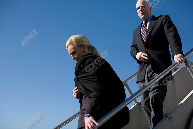 "Senator John McCain, Republican presidential candidate, and his wife, Cindy, disembark from the McCain campaign jet having just flown to Nashville from Chicago, in part of a campaign push to gain ""Super Tuesday"" votes. Nashville, Tennessee, February 2, 2008."