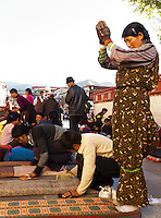 Pilgrims perform prostrations in front of the Jokhang, widely considered the most important and sacred site among Tibetan buddhists