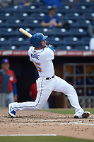 Adam Moore (15) of the Durham Bulls follows through on a solo home run against the Buffalo Bison at Durham Bulls Athletic Park on April 25, 2018 in Allentown, Pennsylvania.  The Bison defeated the Bulls 5-2.  (Brian Westerholt/Four Seam Images)