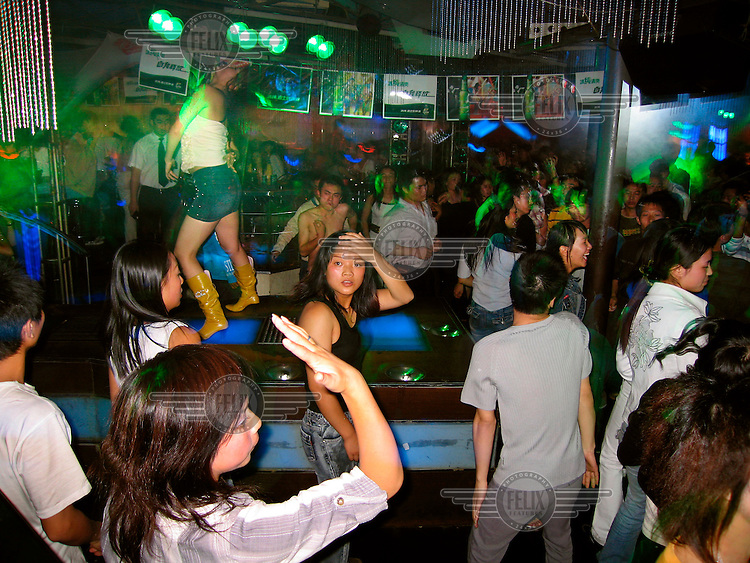 Young clubbers dancing in a night club.