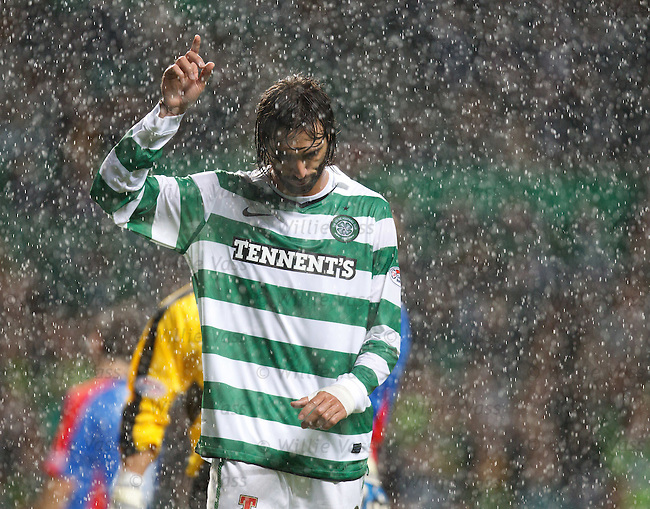 Georgios Samaras celebrates scoring his second goal in the pissing rain