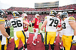 Wisconsin Badgers shake hands after the coin toss prior to an NCAA College Big Ten Conference football game against the Iowa Hawkeyes Saturday, November 11, 2017, in Madison, Wis. The Badgers won 38-14. (Photo by David Stluka)
