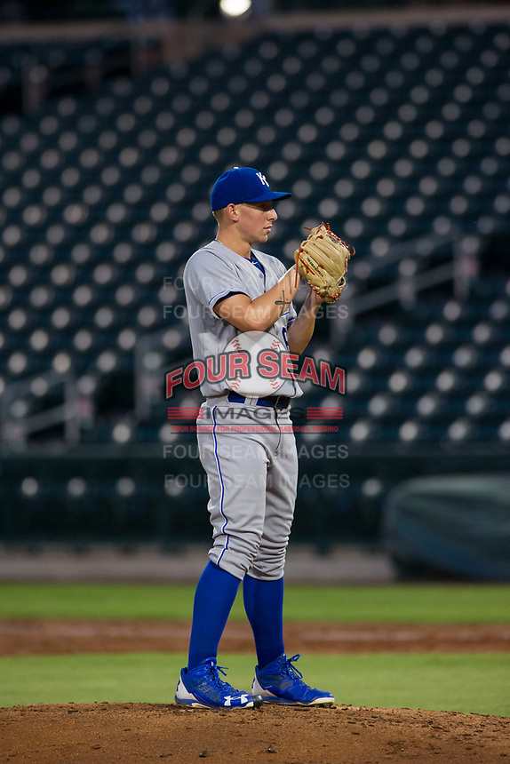 AZL Royals relief pitcher Charlie Neuweiler (62) looks to his catcher for the sign against the AZL Cubs on July 19, 2017 at Sloan Park in Mesa, Arizona. AZL Cubs defeated the AZL Royals 5-4. (Zachary Lucy/Four Seam Images)