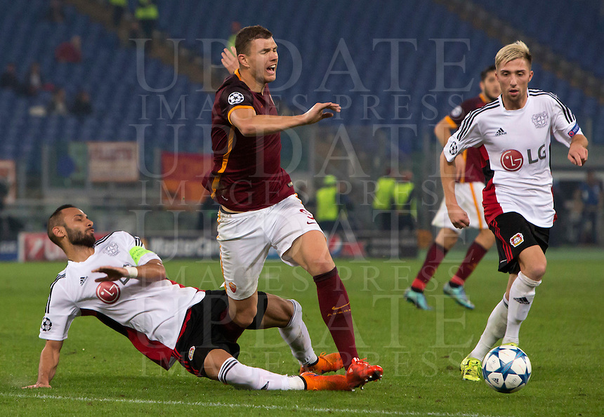 Calcio, Champions League, Gruppo E: Roma vs Bayer Leverkusen. Roma, stadio Olimpico, 4 novembre 2015.<br /> Roma's Edin Dzeko, center, is tackled by Bayer Leverkusen's Omer Toprak during a Champions League, Group E football match between Roma and Bayer Leverkusen, at Rome's Olympic stadium, 4 November 2015.<br /> UPDATE IMAGES PRESS/Riccardo De Luca