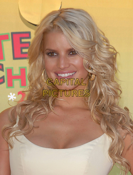 JESSICA SIMPSON.At The 2006 Teen Choice Awards - Arrivals, .held at The Universal Ampitheatre in Universal City, California, USA, August 20th 2006..portrait headshot gold hoop earrings wavy hair.Ref: DVS.www.capitalpictures.com.sales@capitalpictures.com.©Debbie VanStory/Capital Pictures
