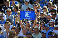 Sep. 20, 2009; San Diego, CA, USA; A San Diego Chargers fan holds up a towel and cheers against the Baltimore Ravens at Qualcomm Stadium in San Diego. Baltimore defeated San Diego 31-26. Mandatory Credit: Mark J. Rebilas-