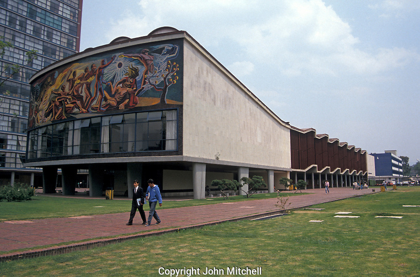 University students with the science auditorium and mural by Jose Chavez Morado in the background, Universidad Nacional Autonoma de Mexico or UNAM in Mexico City. This university campus is a UNESCO World Heritage site.
