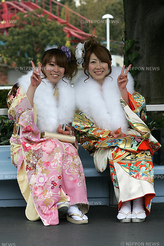 TOKYO - JANUARY 11: Women dressed in traditional kimonos pose for photos to celebrate their entry into adulthood during the annual Coming-of-Age Day ceremony on January 11, 2010 at Tokyo Disneyland in Urayasu city, Chiba prefecture , Japan. (Photo by Laurent Benchana/Nippon News).