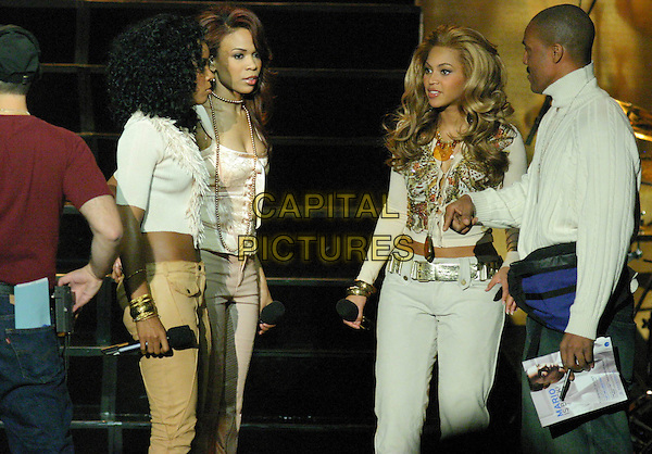 DESTINY'S CHILD.KELLY ROWLAND, MICHELLE WILLIAMS & BEYONCE KNOWLES.Perform in concert on TV programme Good Morning America's concert series, at Roseland Ballroom in New York City, USA, November 16th 2004 ..half length music on stage gig .Ref: IW.www.capitalpictures.com.sales@capitalpictures.com.©Capital Pictures.