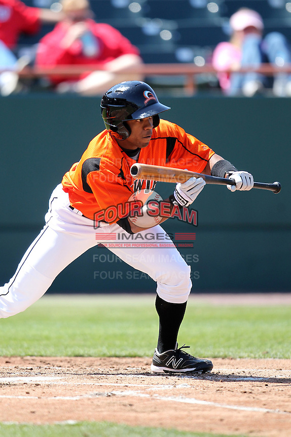 Bowie BaySox outfielder Antoan Richardson #4 bunts during a game against the Harrisburg Senators at Prince George's Stadium on April 8, 2012 in Bowie, Maryland.  Harrisburg defeated Bowie 5-2.  (Mike Janes/Four Seam Images)