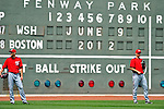 9 June 2012: Washington Nationals bullpen coach Fenway Scoreboard watches batting practice prior to a game against the Boston Red Sox at Fenway Park in Boston, MA. The Nationals defeated the Red Sox 4-2 in the second game of their 3-game series. Mandatory Credit: Ed Wolfstein Photo