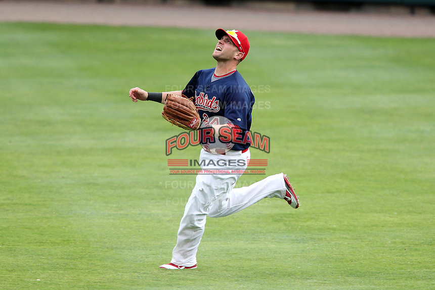 Memphis Redbirds outfielder Andrew Brown #24 chases down a fly ball during a game versus the Round Rock Express at Autozone Park on April 30, 2011 in Memphis, Tennessee.  Memphis defeated Round Rock by the score of 10-7.  Photo By Mike Janes/Four Seam Images