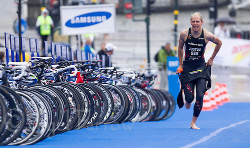 26 AUG 2012 - STOCKHOLM, SWE - Steffen Justus (GER) of Germany  runs through transition at the end of the swim during the 2012 ITU Mixed Relay Triathlon World Championships in Gamla Stan, Stockholm, Sweden (PHOTO (C) 2012 NIGEL FARROW)