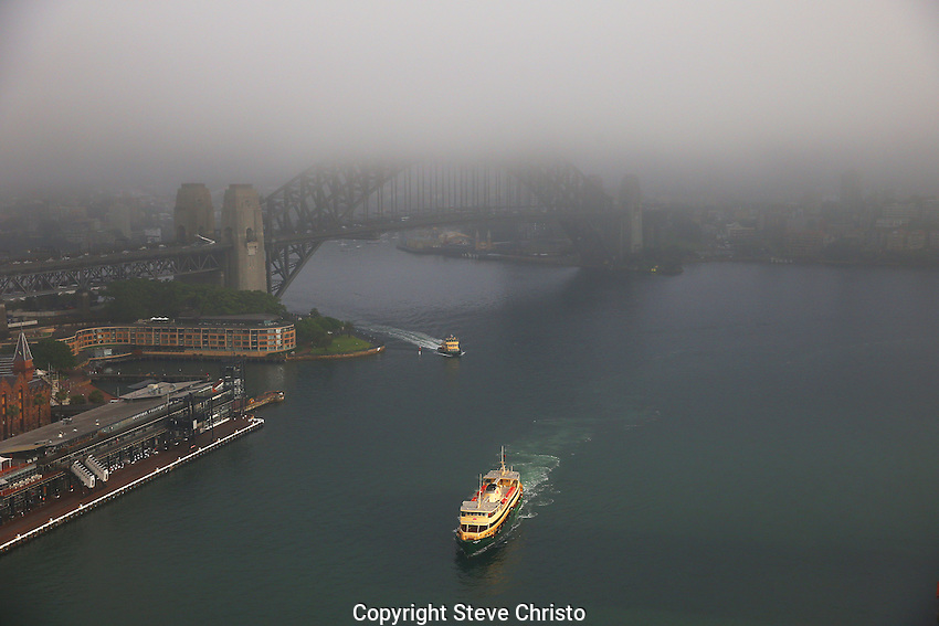 A ferry comes into circular quay on a foggy Sydney morning. Sydney, Australia. Tuesday 12th November, 2013. (Photo Steve Christo)