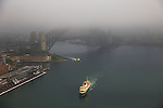 A ferry comes into circular quay on a foggy Sydney morning. Sydney, Australia. Tuesday 12th November, 2013. (Photo Steve Christo)