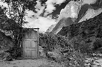 A door is all that is left standing of a building on the right just over the bridge crossing the Rio Urubamba at KM 82, the start of the Inca Trail 4-day hike.