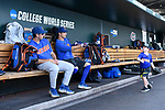 OMAHA, NE - JUNE 26: University of Florida players have fun with head coach Kevin O'Sullivan's son in the dugout before they take on Louisiana State University during the Division I Men's Baseball Championship held at TD Ameritrade Park on June 26, 2017 in Omaha, Nebraska. The University of Florida defeated Louisiana State University 4-3 in game one of the best of three series. (Photo by Jamie Schwaberow/NCAA Photos via Getty Images)