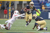 Annapolis, MD - October 8, 2016: Navy Midshipmen running back Toneo Gulley (2) breaks a tackle during game between Houston and Navy at  Navy-Marine Corps Memorial Stadium in Annapolis, MD.   (Photo by Elliott Brown/Media Images International)