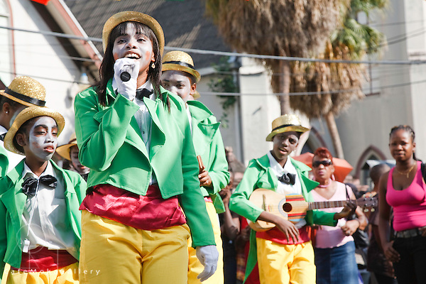Trinidad Carnival, Junior Traditional Mas parade, Minstrel girl performing her song in the street, Port of Spain
