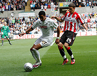 Npower Championship, Swansea City FC (white) V Sheffield United. Sat 7th May 2011 (12.45pm KO)<br /> Pictured: Scott Sinclair of Swansea is pressed into the corner by Matthew Lowton<br /> Picture by: Ben Wyeth / Athena Picture Agency<br /> info@athena-pictures.com<br /> 07815 441513
