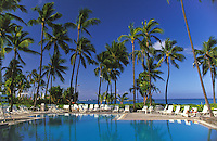 Palms surround the oceanside pool at the Hale Koa Hotel in Waikiki, a hotel for active and retired military.