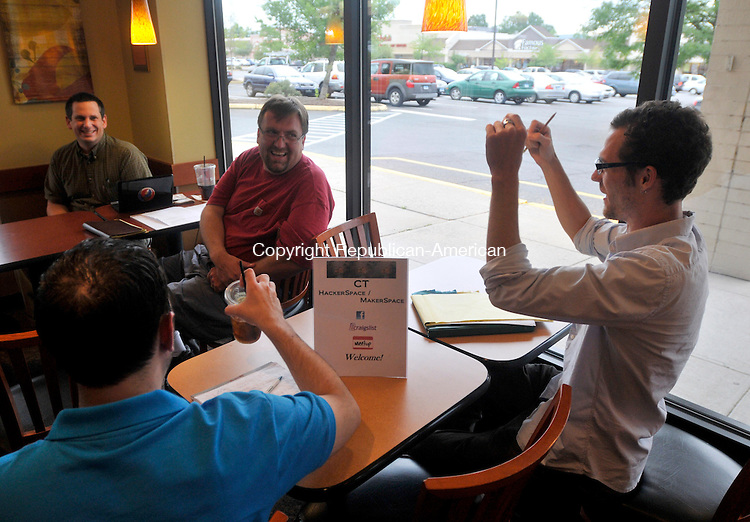 MERIDEN, CT-14 JULY 2010-071410IP04- (l to r) Jeff Myer of Middlebury, Bill Saturno of Waterbury,  Joe Rinaldi of Waterbury and Wil Koch of Madison talk during a meeting of local hackers at Panera Bread in Meriden on Wednesday.                                                                                                                                                                                                                                                                                                                                                                                                                                                                                                                                                                                                                                                                                                                                                                                                           <br /> Irena Pastorello Republican-American