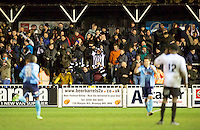Grimsby Town Fans celebrate their win by 1-2 in the Vanarama National League match between Bromley and Grimsby Town at Hayes Lane, Bromley, England on 9 February 2016. Photo by Alan  Stanford.