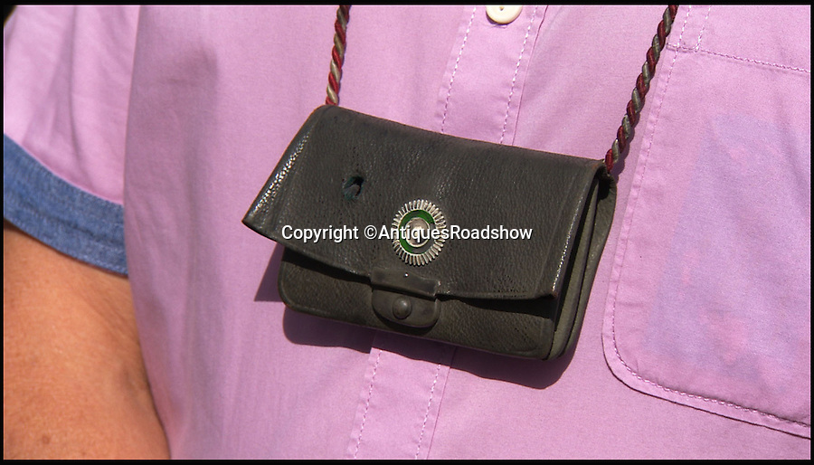 BNPS.co.uk (01202 558833)<br /> Pic: AntiquesRoadshow/BNPS<br /> <br /> ***Please Use Full Byline***<br /> <br /> The German purse which contained the life saving medal. <br />  <br /> This extraordinary relic of the First World War shows how a humble medal saved a German soldier's life by stopping a British bullet aimed at his chest.<br /> <br /> The round fired from a Lee Enfield rifle pierced through the middle of the 2ins silver medal and jammed tight, leaving the front and back of it protruding like a spinning top.<br /> <br /> The item will feature on this Sunday's Antiques Roadshow on BBC1.