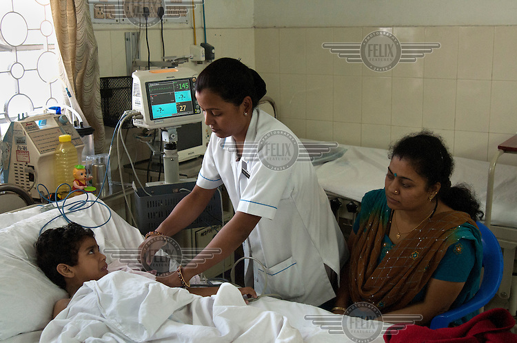 A child is treated on the intensive care unit in the children's ward of the Tata Main Hospital.