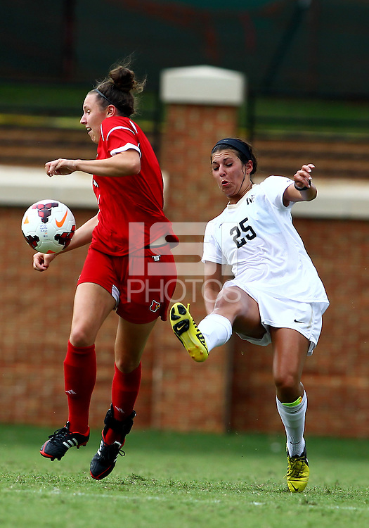 WINSTON-SALEM, NORTH CAROLINA - September 01, 2013:<br />  Kari Weinland  (7) of Louisville University loses the ball to Annick McBryar (25)of Wake Forest University during a match at the Wake Forest Invitational tournament at Wake Forest University on September 01. The match was abandoned early in the second half due to severe weather with Wake leading 1-0.