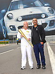 daley thompson and Paul Kelsey  torchbearer at the Olympic Torch Relay at MINI Plant Oxford on Monday 9th July 2012  Picture By: Brian Jordan / Retna Pictures.. ..-..