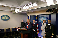 United States President Donald J. Trump speaks during a press briefing on the Coronavirus COVID-19 pandemic with members of the Coronavirus Task Force at the White House in Washington on March 19, 2020.  Pictured behind the President are: Stephen Hahn, Commissioner, US Food and Drug Administration (FDA), Dr. Deborah L. Birx, White House Coronavirus Response Coordinator, and US Surgeon General Vice Admiral (VADM) Jerome M. Adams, M.D., M.P.H.<br /> Credit: Yuri Gripas / Pool via CNP/AdMedia