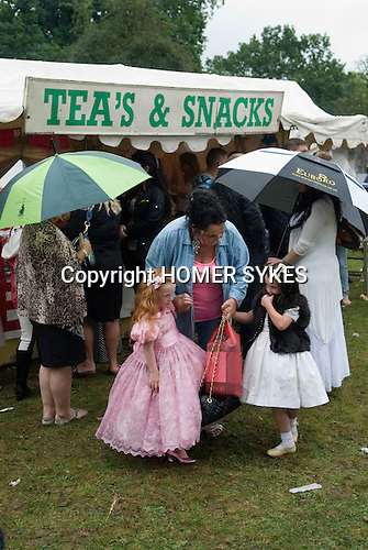 Barnet Gypsy Horse Fair Hertfordshire UK. Children girls dressed in best cloths with grandmother. September annually for over 800 years.