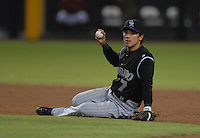 Oct 11, 2007; Phoenix, AZ, USA; Colorado Rockies second baseman (7) Kazuo  Matsui sits on the ground after being upended by Arizona Diamondbacks right fielder (10) Justin Upton on a double play attempt in the seventh inning during game 1 of the 2007 National League Championship Series at Chase Field. Upton was ruled out for player interference. Mandatory Credit: Mark J. Rebilas-US PRESSWIRE