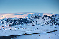 Cars motoring on Main Road in Southern Iceland with Katla volcano behind under glacier ice cap, in Katla Geopark near Vik, Iceland