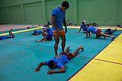 Jasmer Singh, one of the Indian Kabbadi team player stands on the back of his team mate to relax muscles after the training session at a month long camp in Sport Authority of India Sports Complex in Bisankhedi, outskirts of Bhopal, Madhya Pradesh, India.