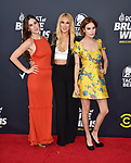 HOLLYWOOD, CA - JULY 14: (L-R) Scout Willis, Rumer Willis and Tallulah Willis arrive at the Comedy Central Roast Of Bruce Willis at the Hollywood Palladium on July 14, 2018 in Los Angeles, California.