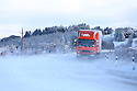 A lorry battles though the snow covered roads high on the hill roads around Belfast, Northern Ireland, Thursday Jan 29th, 2015. A number of schools where forced to close due to the weather along with bus services. Photo/Paul McErlane