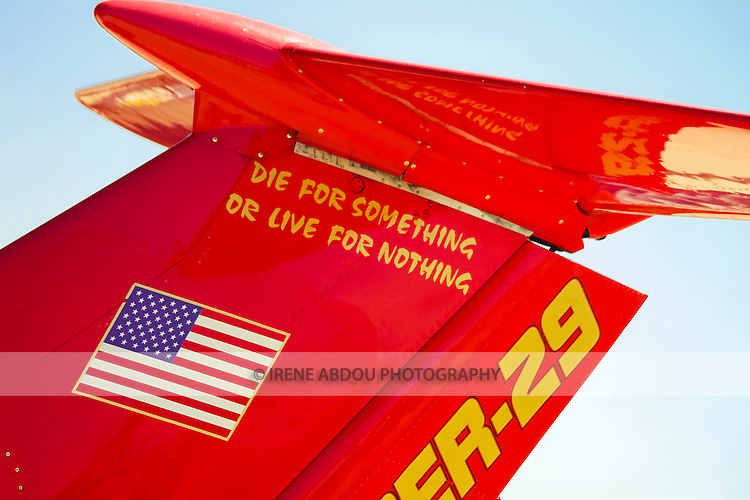 "A fighter plane on display at the Joint Service Open House at Andrews Air Force Base in Maryland bears the slogan, ""Die for something or live for nothing."""