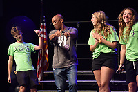 NWA Democrat-Gazette/DAVID GOTTSCHALK John L. Colbert (second from left), superintendent of Fayetteville Public Schools, dances Wednesday, August 7, 2019, with students during the Fayetteville Public Schools annual Convocation ceremony in Bulldog Arena on the Fayetteville High School campus. The event, which features performances by students, informational presentations and awards, serves as a kickoff to the school year which begins Tuesday in Fayetteville.