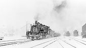 D&amp;RGW #491 with westbound pipe train in Chama yard.  Snowstorm in progress.<br /> D&amp;RGW  Chama, NM  Taken by Richardson, Robert W. - 12/31/1950