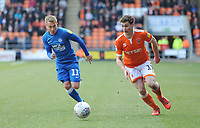 Blackpool's Matthew Virtue under pressure from Peterborough United's Louis Reed<br /> <br /> Photographer Kevin Barnes/CameraSport<br /> <br /> The EFL Sky Bet League One - Blackpool v Peterborough United - Saturday 13th April 2019 - Bloomfield Road - Blackpool<br /> <br /> World Copyright &copy; 2019 CameraSport. All rights reserved. 43 Linden Ave. Countesthorpe. Leicester. England. LE8 5PG - Tel: +44 (0) 116 277 4147 - admin@camerasport.com - www.camerasport.com