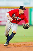 Shortstop Nick Ahmed #22 of the Danville Braves tracks a ground ball against the Burlington Royals at Burlington Athletic Park on August 14, 2011 in Burlington, North Carolina.  The Braves defeated the Royals 10-2 in a game called by rain in the bottom of the 8th inning.   (Brian Westerholt / Four Seam Images)