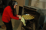 Palestinian woman making a traditional sweets preparing for Eid Al-Adha in the west bank city of Nablus on Nov 25,2009. Photo by Nedal Shtieh