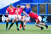 Cyrielle Banet of France is tackled by Alisha Butchers of Wales during the Women's Six Nations Championship Round 3 match between Wales and France at the Cardiff Arms Park in Cardiff, Wales, UK. Sunday 23 February 2020