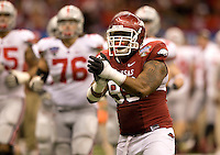 Lavunce Askew of Arkansas in action against Ohio State during 77th Annual Allstate Sugar Bowl Classic at Louisiana Superdome in New Orleans, Louisiana on January 4th, 2011.  Ohio State defeated Arkansas, 31-26.