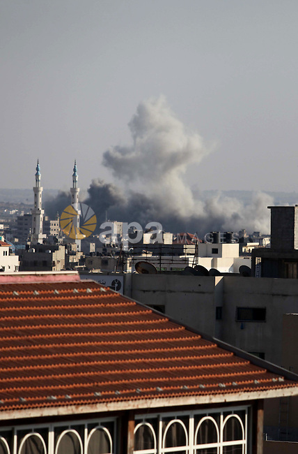 Smoke rises over Gaza City after an Israeli airstrike on Friday, August 08, 2014.  Israel launched air strikes across the Gaza Strip on Friday in response to Palestinian rockets fired after Egyptian-mediated talks failed to extend a 72-hour truce in the month-long war. Photo by Ashraf Amra